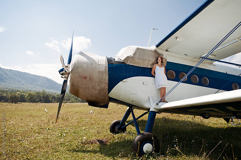 Woman on the wing of a airplane by Svetlana Shchemeleva for Stocksy United