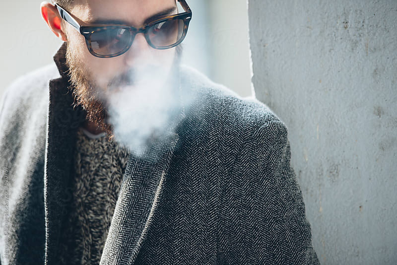 Cool Man With Beard Covered in Smoke by Nemanja Glumac for Stocksy United