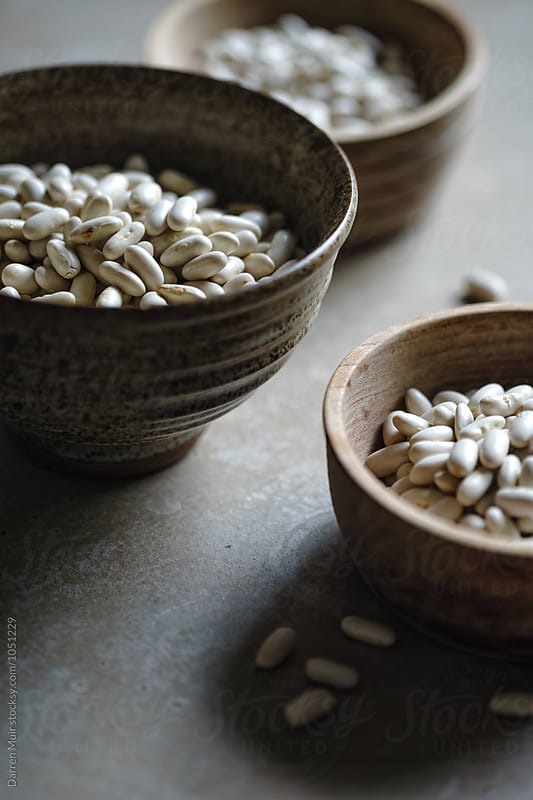 Cannellini beans ready to be prepared for a recipe. by Darren Muir for Stocksy United