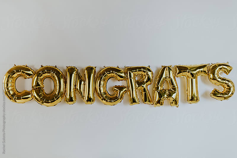 Hanging Gold Congrats Balloon Letters by Rachel Gulotta Photography for Stocksy United