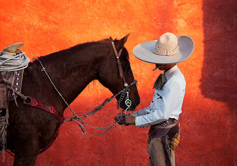 Mexican Cowboy with horse. by Hugh Sitton for Stocksy United