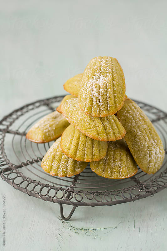 Pistachio madeleines on cooling wrack by Noemi Hauser for Stocksy United