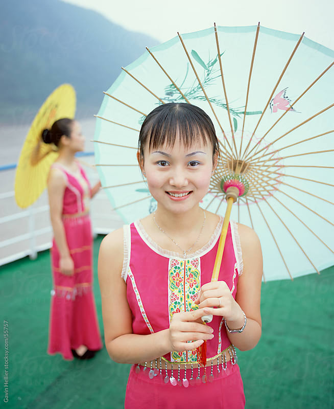 Smiling young woman, Yangtze River, Chongqing, Chongqing City, Sichuan Province, China by Gavin Hellier for Stocksy United