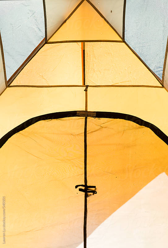 View of ceiling inside yellow tent by Lawren Lu for Stocksy United