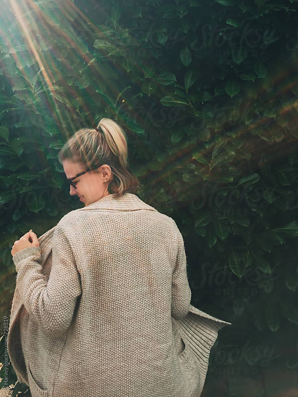 Girl Dancing in a Sweater in the Sunshine by B. Harvey for Stocksy United