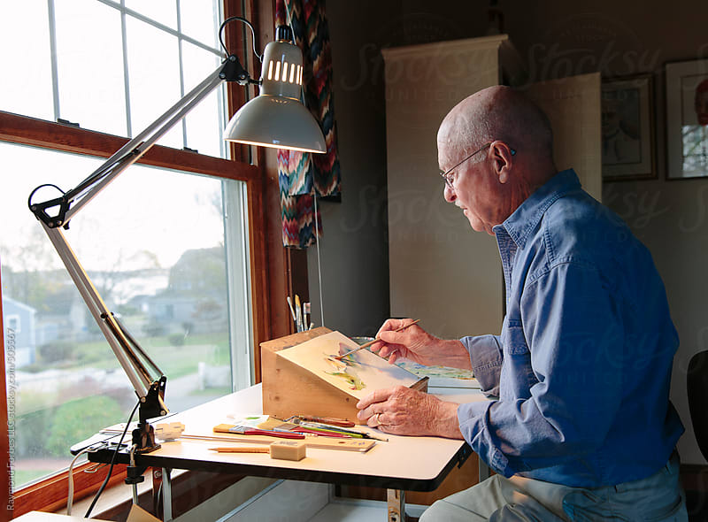 Senior Artist Working in His Studio at home by Raymond Forbes LLC for Stocksy United