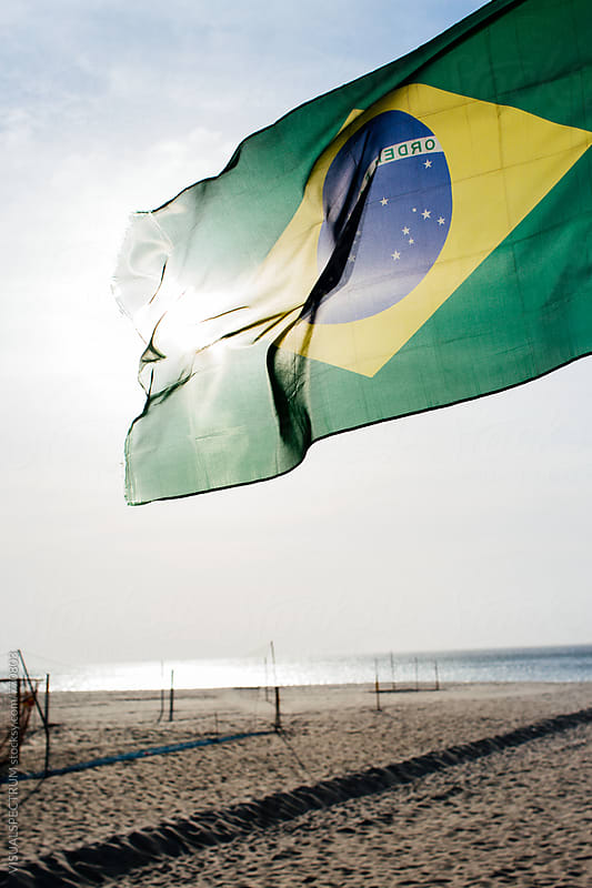 Rio de Janeiro - Brazilian Flag Blowing in Wind on Copacabana Beach by Julien L. Balmer for Stocksy United