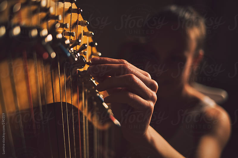 Woman Playing the Harp by Lumina for Stocksy United