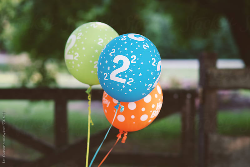 Colorful balloons with number 2 on them by Lea Csontos for Stocksy United