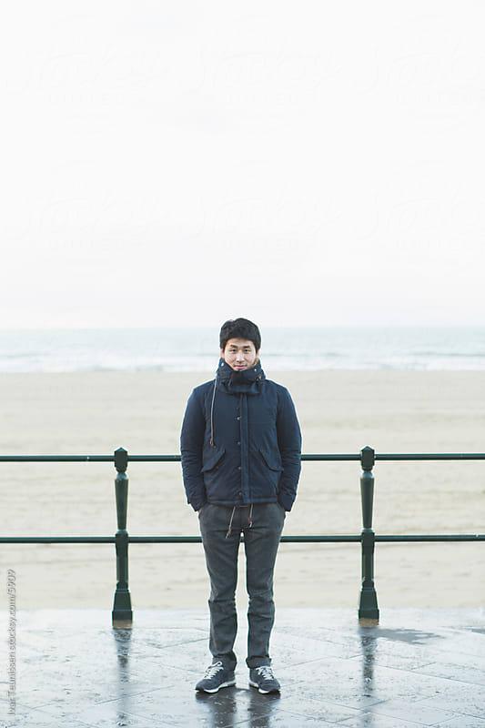 Japanese man on beach by Ivar Teunissen for Stocksy United