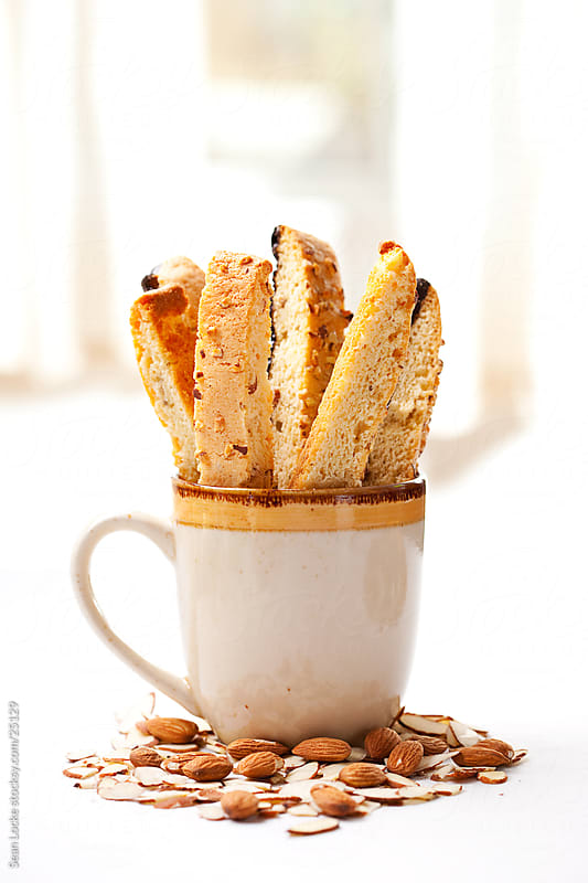 Biscotti: Coffee Mug Filled with Biscotti by Sean Locke for Stocksy United