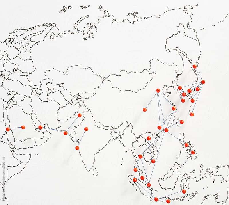 Busiest flights in Asian on map with red pins by Martí Sans for Stocksy United