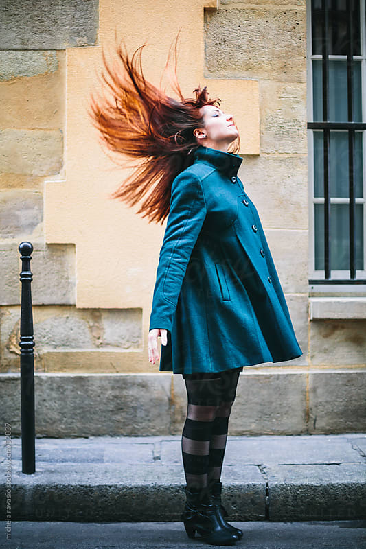Young Redheaded Woman with Flowing Hair by michela ravasio for Stocksy United