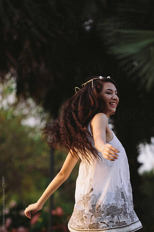 Asian girl dancing in the park by michela ravasio for Stocksy United