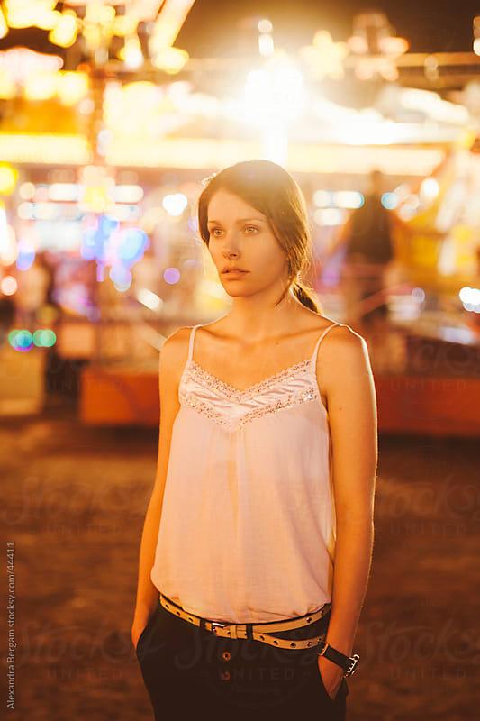 Beautiful woman at amusement park by Aleksandra Kovac for Stocksy United