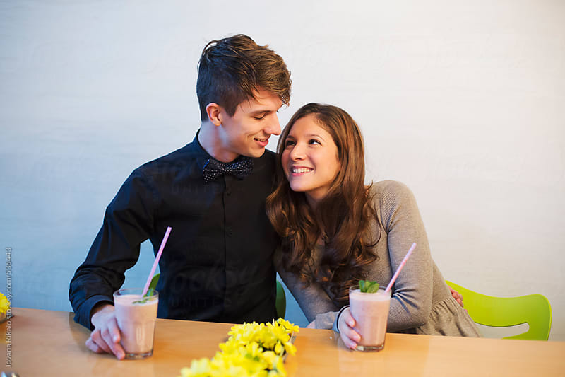 Happy couple in a coffee bar by Jovana Rikalo for Stocksy United