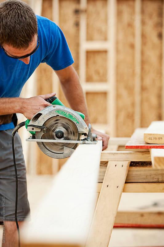 Construction: Framer Using Radial Saw To Cut Board by Sean Locke for Stocksy United
