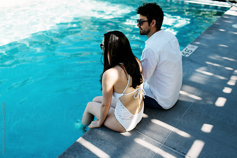 Lovers by the pool by Matt and Tish for Stocksy United