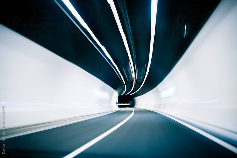 Abstract blurred speed motion in urban highway road  by Davide Illini for Stocksy United