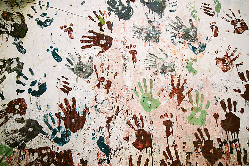 A wall of hand prints in Stone Town, Zanzibar by Helen Rushbrook for Stocksy United