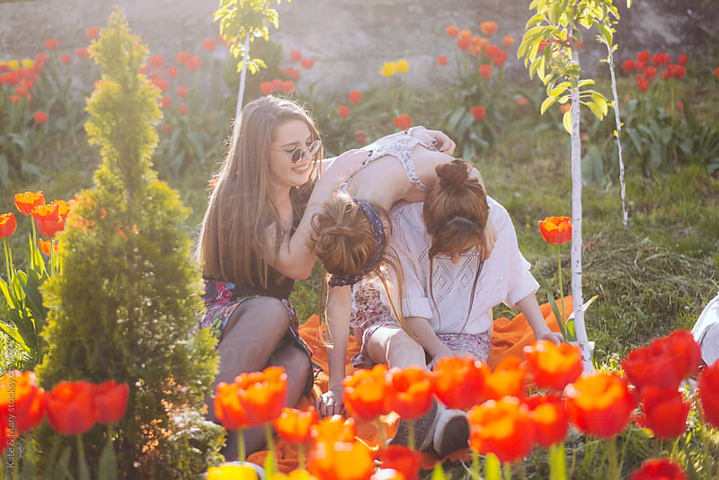 Three girls enjoying outside by Katarina Simovic for Stocksy United