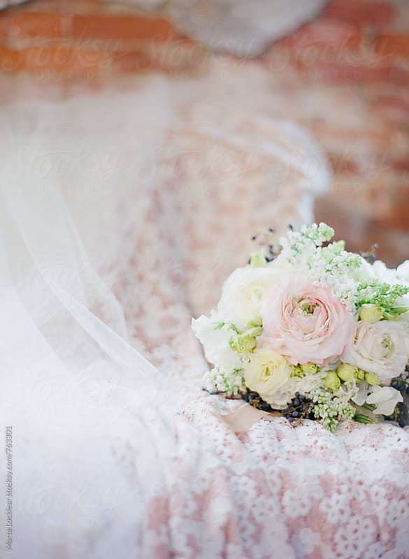 Wedding gown, veil and bouquet by Marta Locklear for Stocksy United