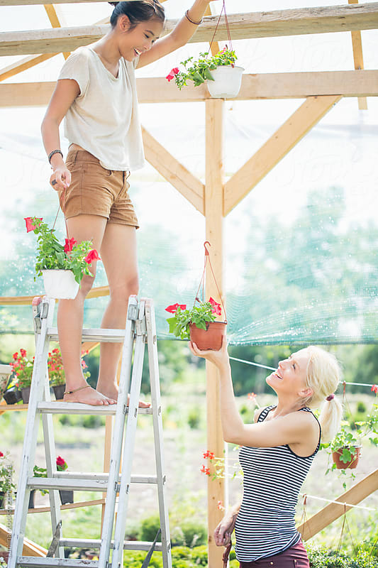 Women Decorating the Garden by Lumina for Stocksy United