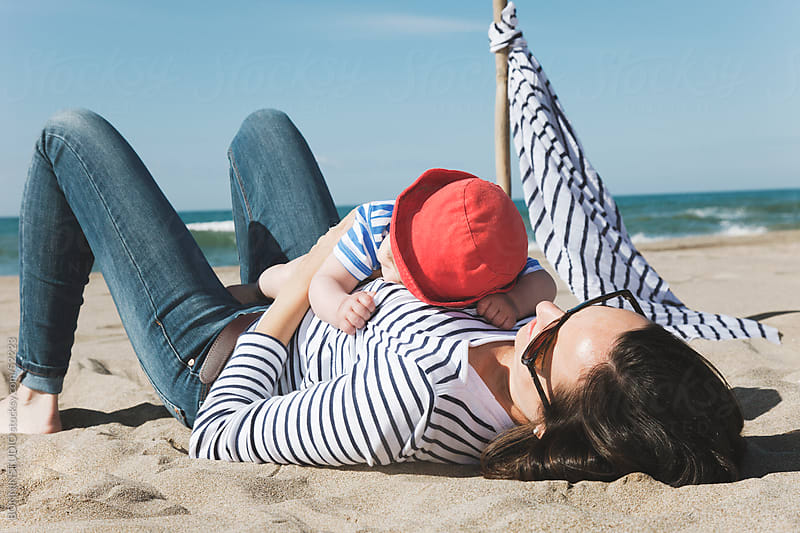 Mom with her baby sleeping on the beach by BONNINSTUDIO for Stocksy United