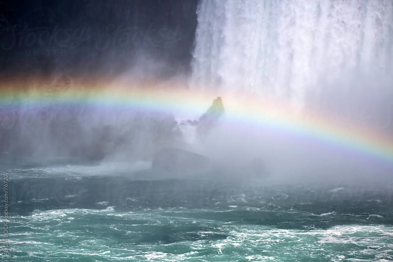 A Colorful Rainbow Across A Waterfall by ALICIA BOCK for Stocksy United