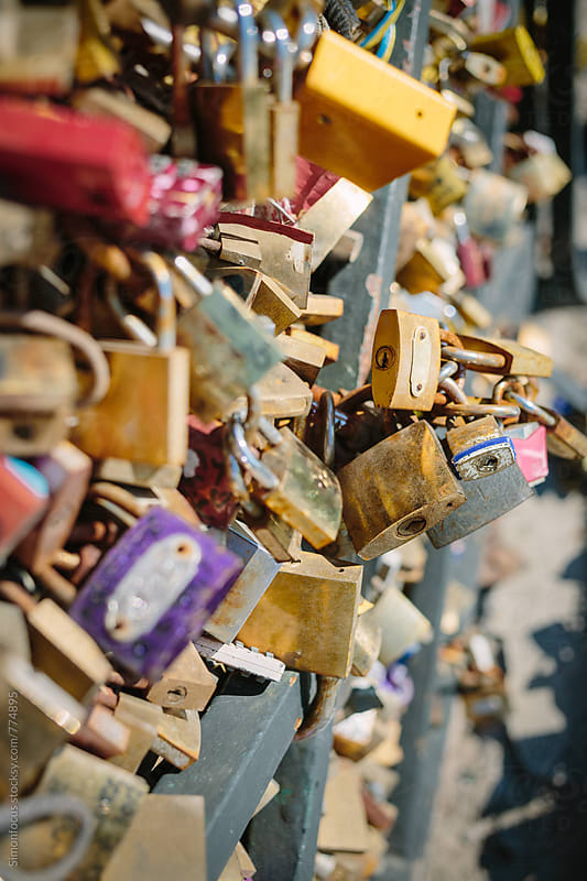 Love locks on the Pont des Arts by Simon DesRochers for Stocksy United