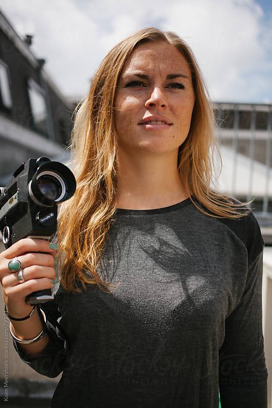 Good looking woman holding a old vintage camera by Koen Meershoek for Stocksy United