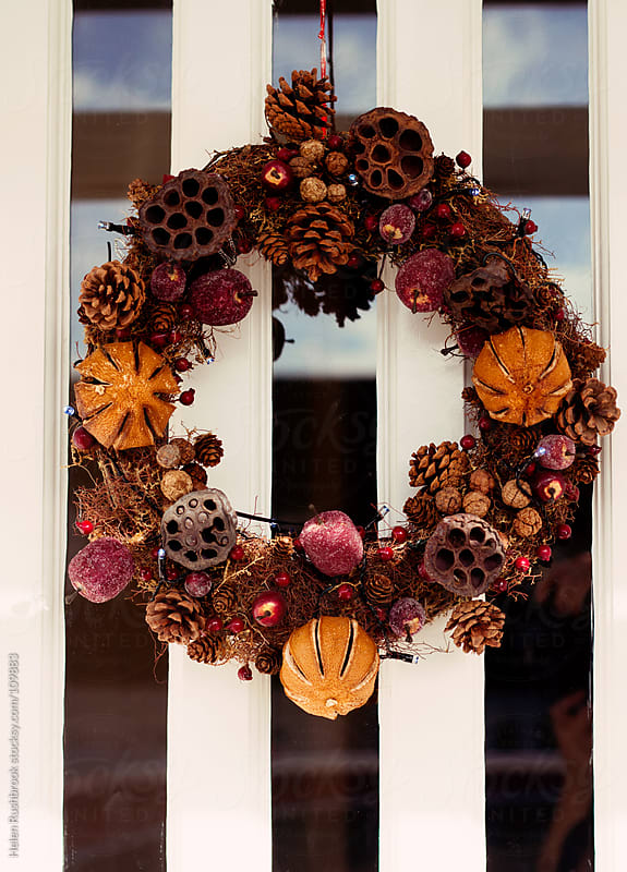 a christmas wreath by Helen Rushbrook for Stocksy United
