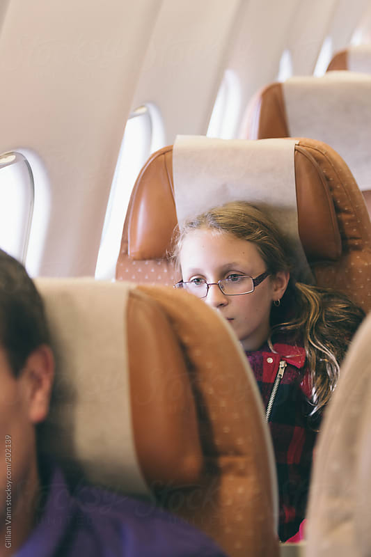 child on airplaine by Gillian Vann for Stocksy United