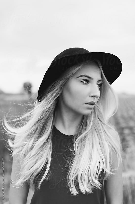 Black and white windy portrait by Jovana Rikalo for Stocksy United
