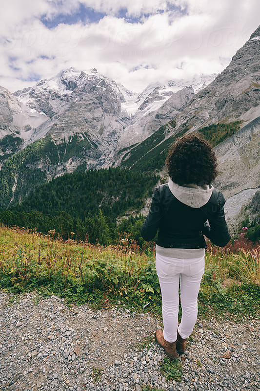 Young woman alone in the Stelvio National Park by Davide Illini for Stocksy United