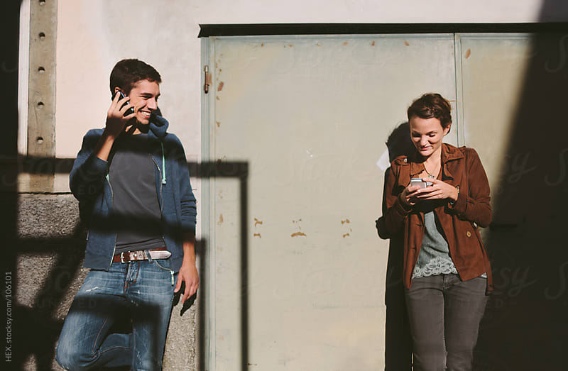 Young Couple Have Have With Phone by HEX. for Stocksy United