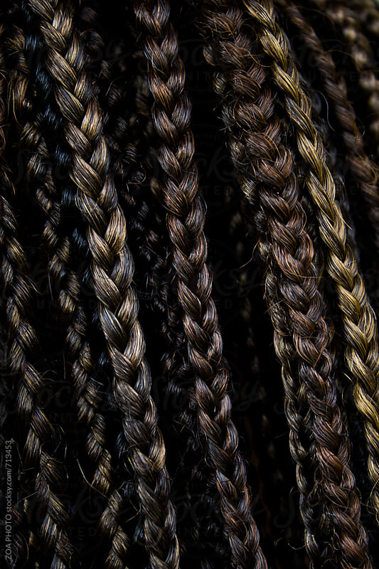Close-up of braided hair by ZOA PHOTO for Stocksy United