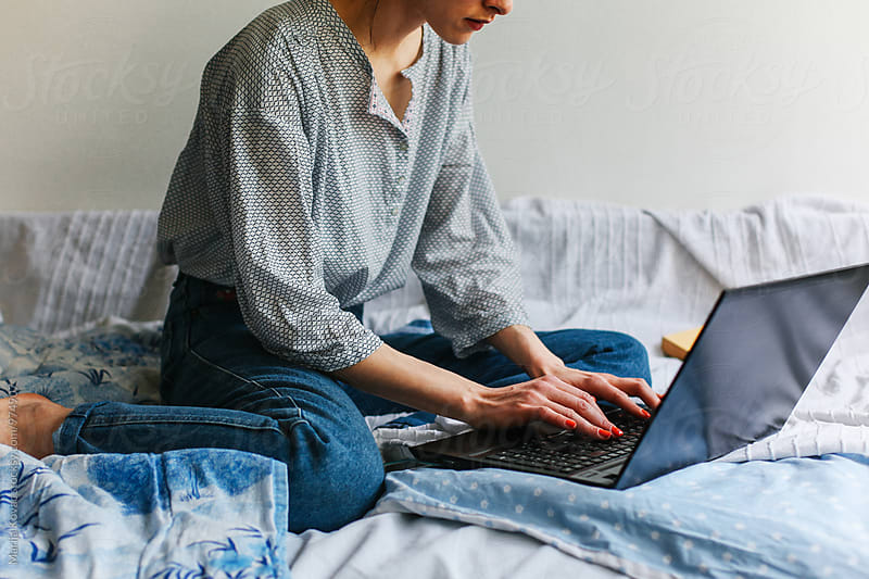 Female person typing on her laptop by Marija Kovac for Stocksy United