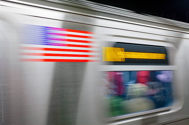 United States of America, New York, New York City, Manhattan, Subway Station and train in motion by Gavin Hellier for Stocksy United