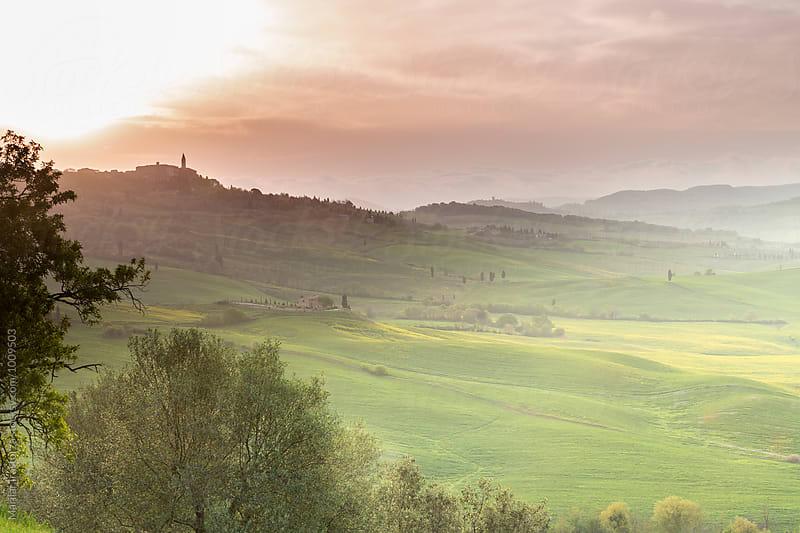 Tuscan landscape at sunrise by Marilar Irastorza for Stocksy United