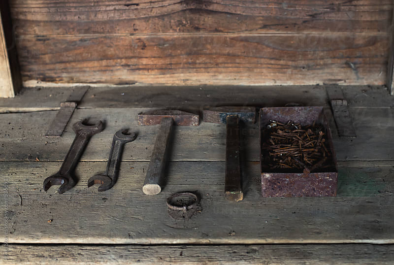 Rusty nails and tools by Pixel Stories for Stocksy United