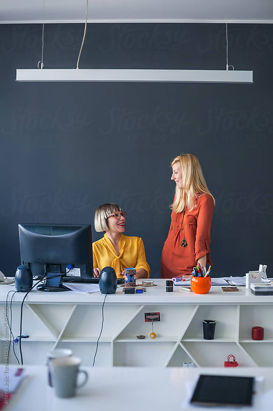 Businesswomen at the office by Jelena Jojic Tomic for Stocksy United