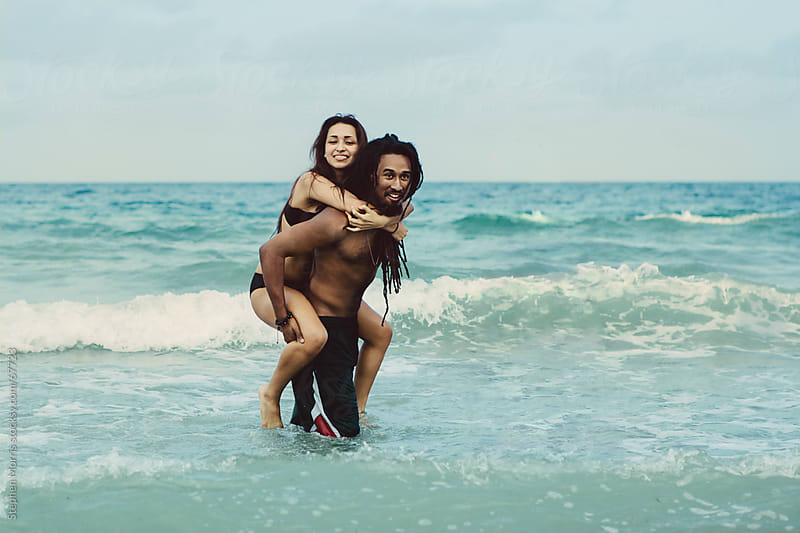 Playful Couple at the Beach by Stephen Morris for Stocksy United