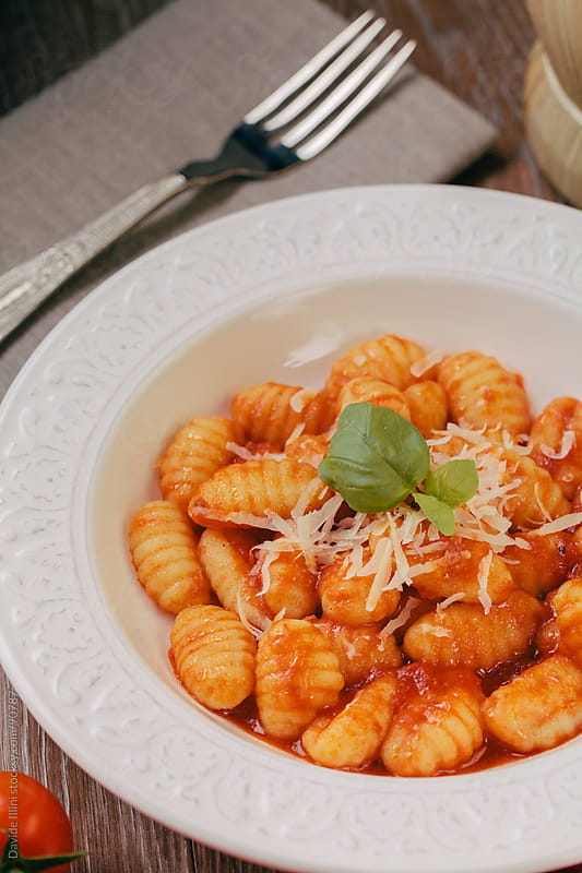 Gnocchi with tomato sauce by Davide Illini for Stocksy United