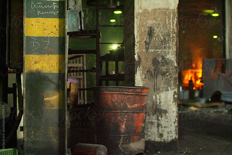 melting metal old factory by Marija Anicic for Stocksy United