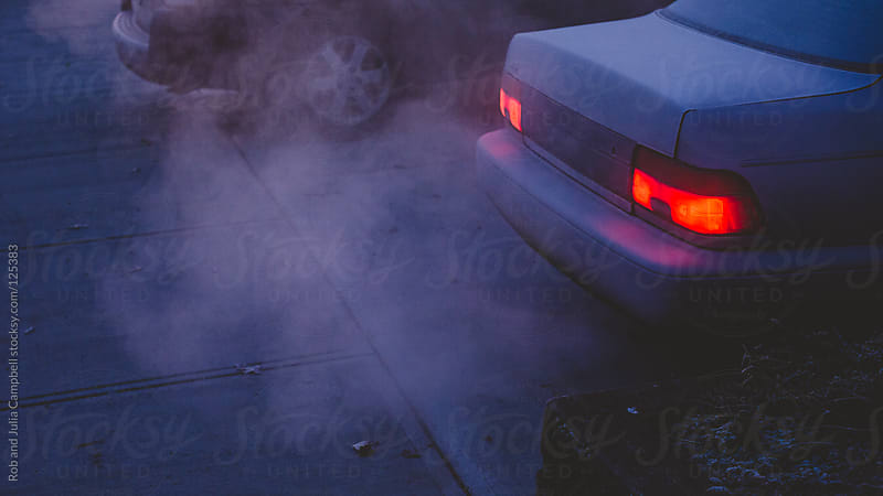 Car exhaust in early, frosty morning by Rob and Julia Campbell for Stocksy United