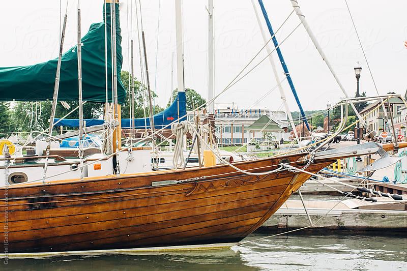 Vintage wood sailboat in a pier by Gabriel (Gabi) Bucataru for Stocksy United