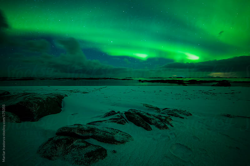 Aurora borealis over Eggum beach by Marilar Irastorza for Stocksy United