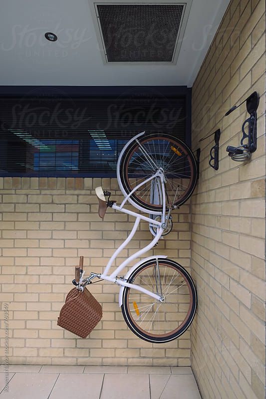 Retro bike hung on wall by Rowena Naylor for Stocksy United
