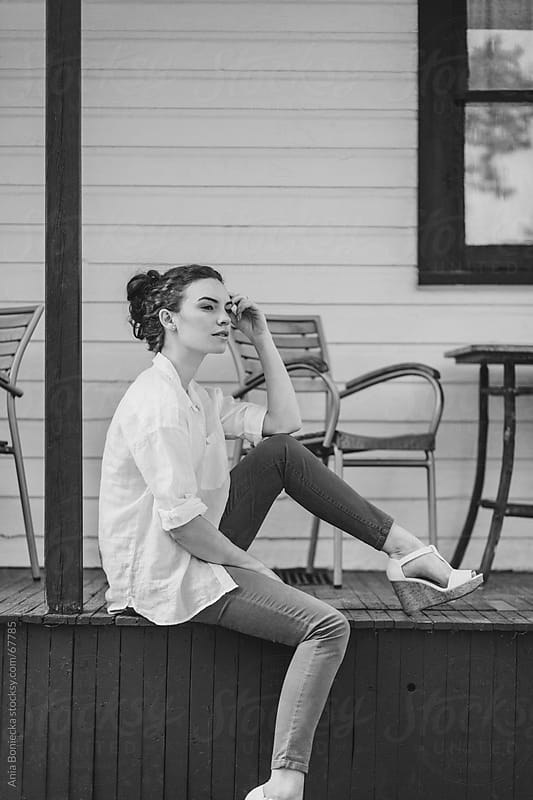 Beautiful young woman relaxing: black and white by Ania Boniecka for Stocksy United